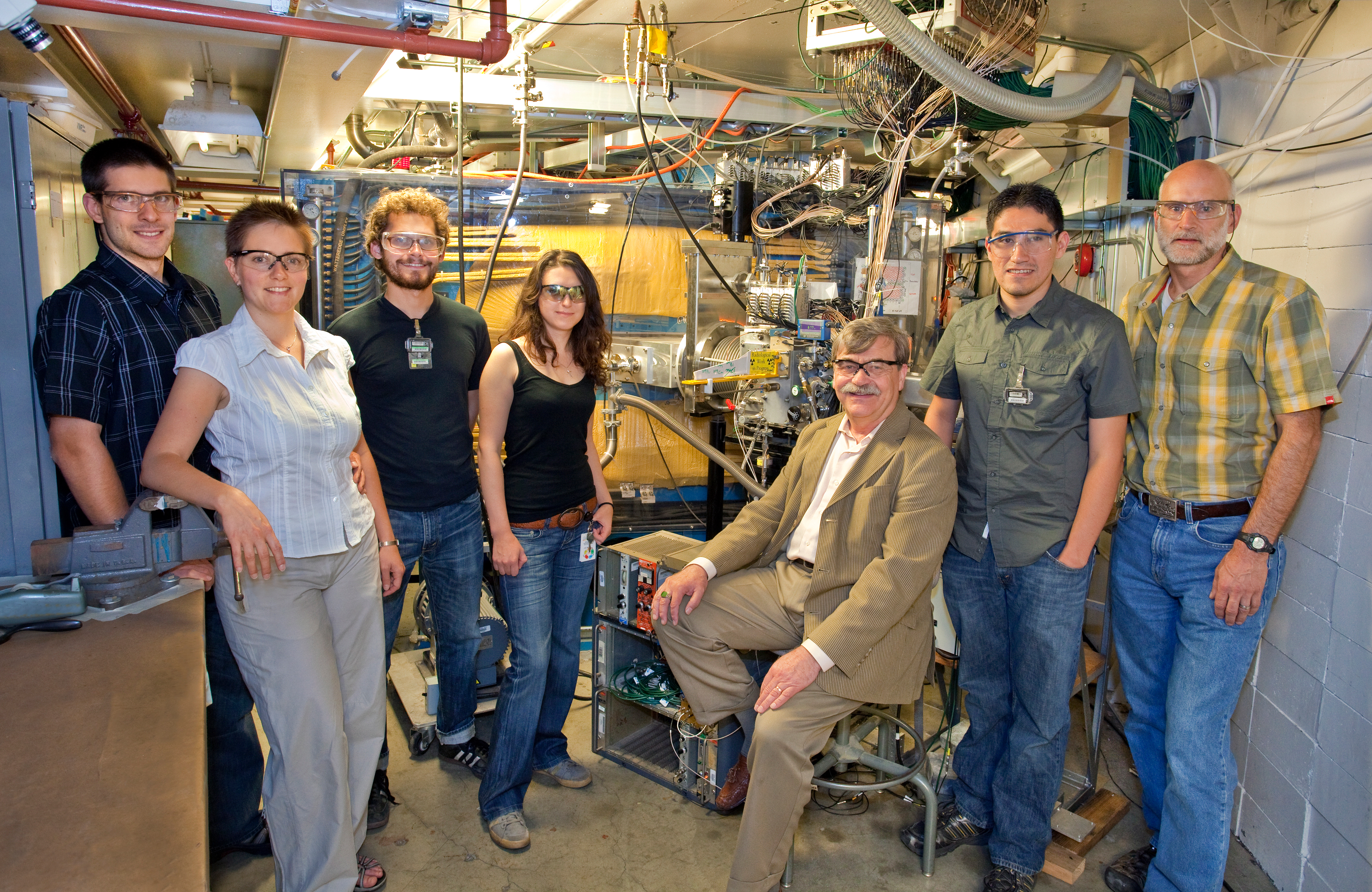 Members of the group that confirmed the production of element 114 in front of the Berkeley Gas-filled Separator at the 88-Inch Cyclotron, from left: Jan Dvorak, Zuzana Dvorakova, Paul Ellison, Irena Dragojevic, Heino Nitsche, Mitch Andre Garcia, and Ken Gregorich. Not pictured in Liv Stavestra. (Photo by Roy Kaltschmidt, Berkeley Lab Creative Services Office. For best resolution, click on image.)
