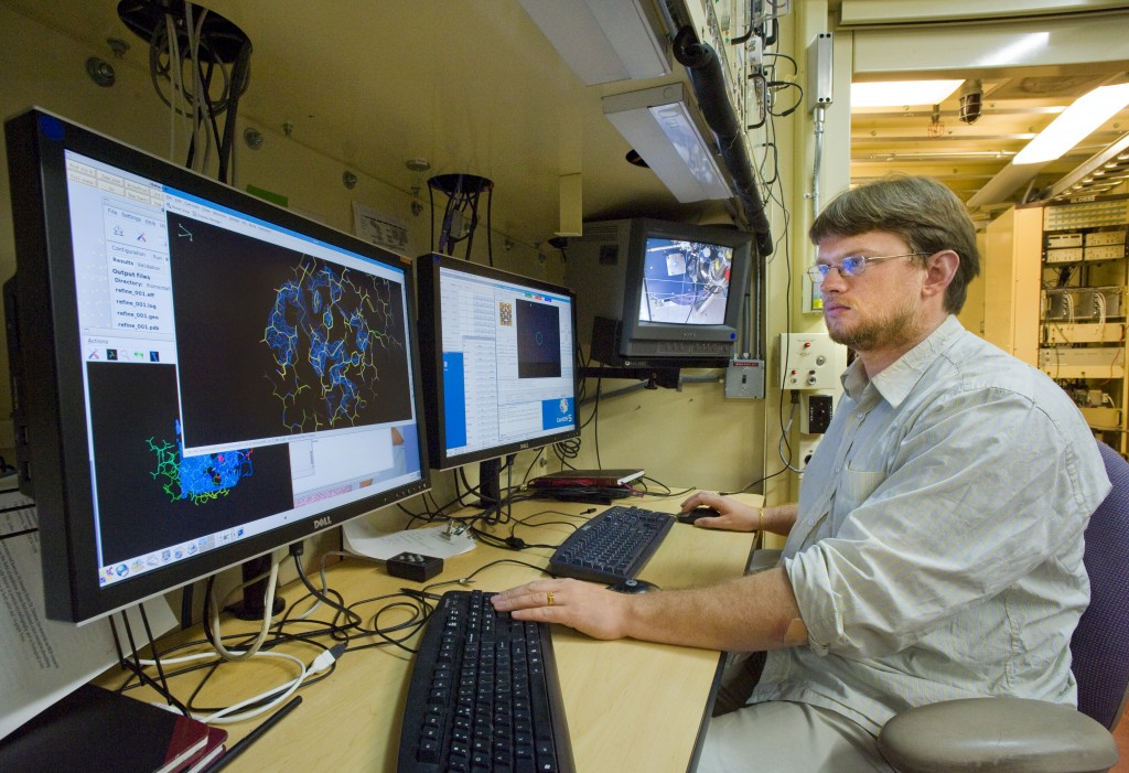 Keeping pace with genomics. Berkeley Lab's Peter Zwart at the Advanced Light Source's beamline 5.0.2, which is equipped to churn out atomic-scale resolution images of proteins.