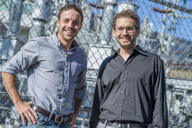 Sebastien Lounis (left) and Ilan Gur head up Cyclotron Road. (Photo credit: Berkeley Lab)