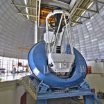 Photo - A view inside the dome at the Mayall Telescope in Arizona. The telescope's 2-meter corrector barrel will be removed and replaced with a new corrector barrel for the Dark Energy Spectroscopic Instrument. DESI's installation will begin soon at the telescope. (Credit: P. Marenfeld and NOAO/AURA/NSF)