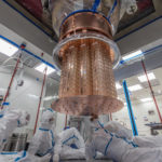 Photo - Researchers work on the assembly of the CUORE experiment prior to its placement in a deep-chilling cryostat. (Credit: CUORE Collaboration)