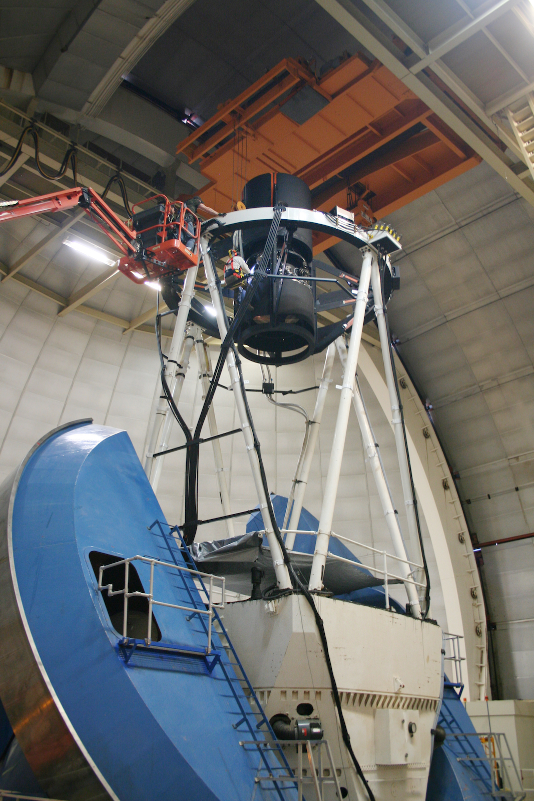 Photo - Workers install a component on DESI, which is mounted on the Mayall Telescope at Kitt Peak National Observatory. (Photo courtesy of Robert Besuner/DESI collaboration)