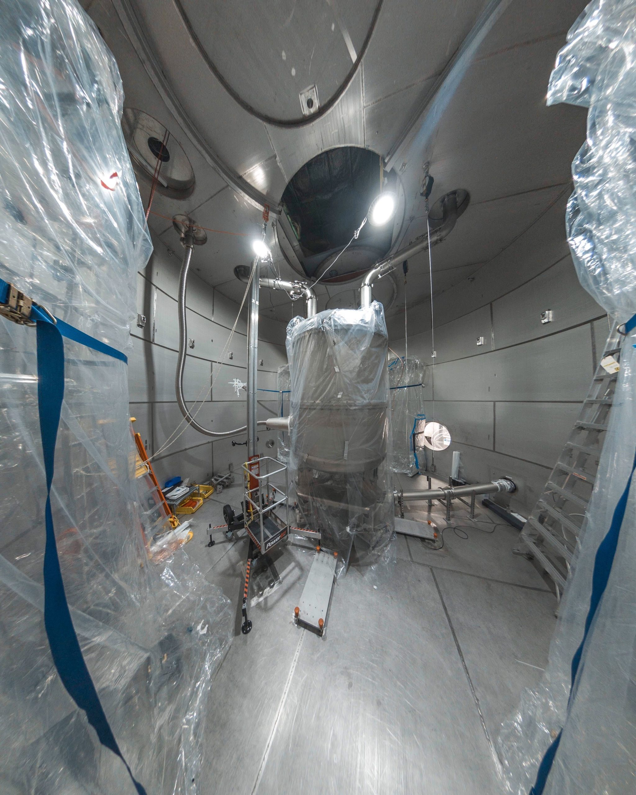 Image - LZ's central detector, pictured here during assembly, is located inside a large water tank on the 4850 Level of Sanford Lab. LZ will search for theoretical dark matter particles known as WIMPs. (Credit: Nick Hubbard/Sanford Lab)