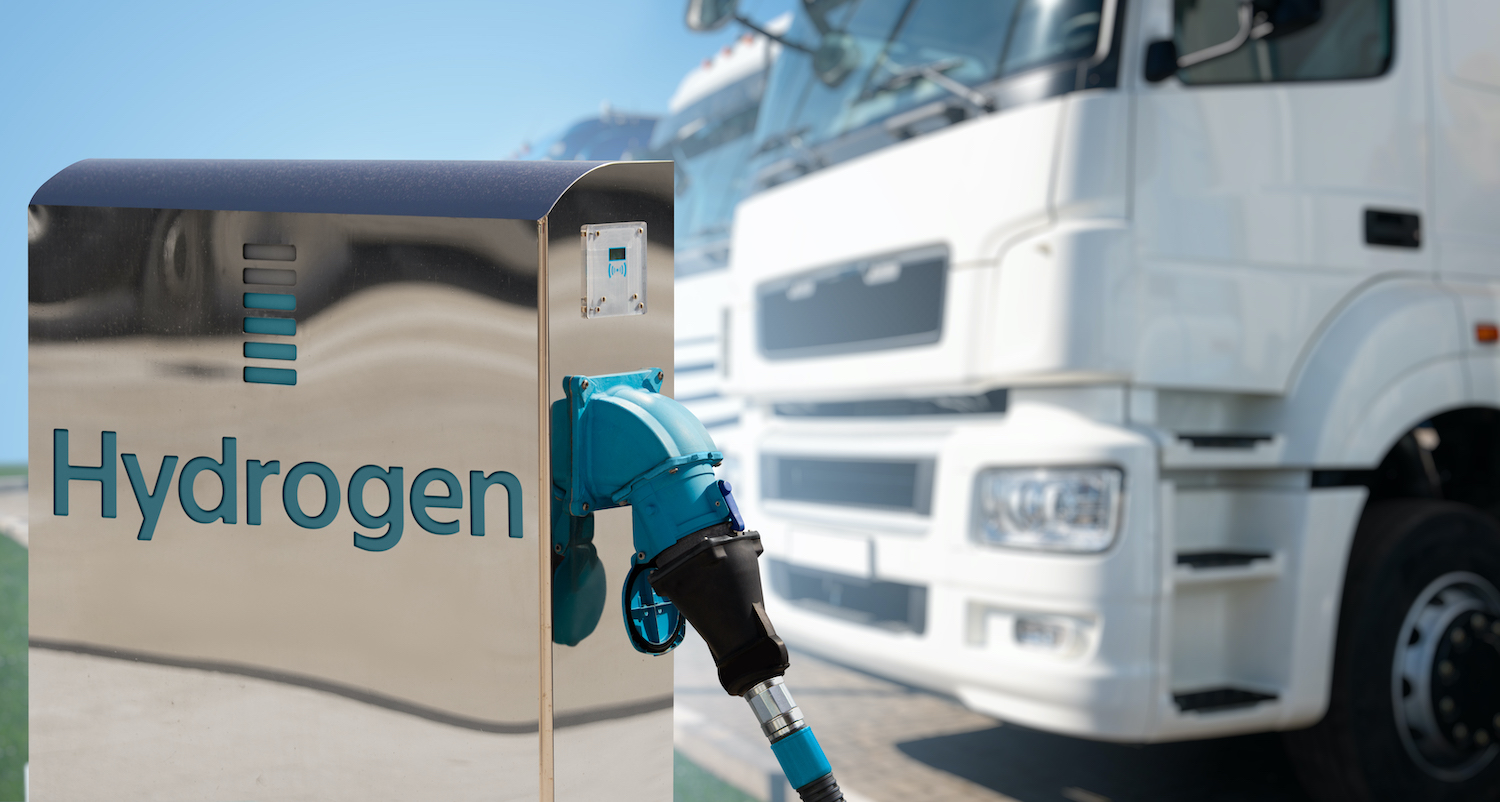 stock photo of Hydrogen filling station on a background of trucks