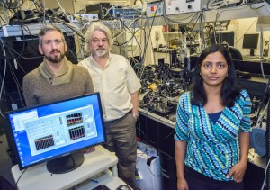 From left, Brett Helms, Frank Ogletree and Sumanjeet Kaur at the Molecular Foundry used organic molecules to form strong covalent bonds between carbon nanotubes and metal surfaces, improving by six-fold the flow of heat from the metal to the carbon nanotubes. (Photo by Roy Kaltschmidt)